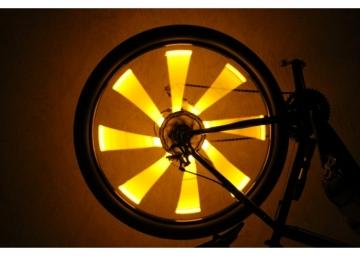 Оранжевая велоподсветка колес велосипеда